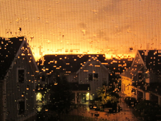 macro window screen sunset after the storm